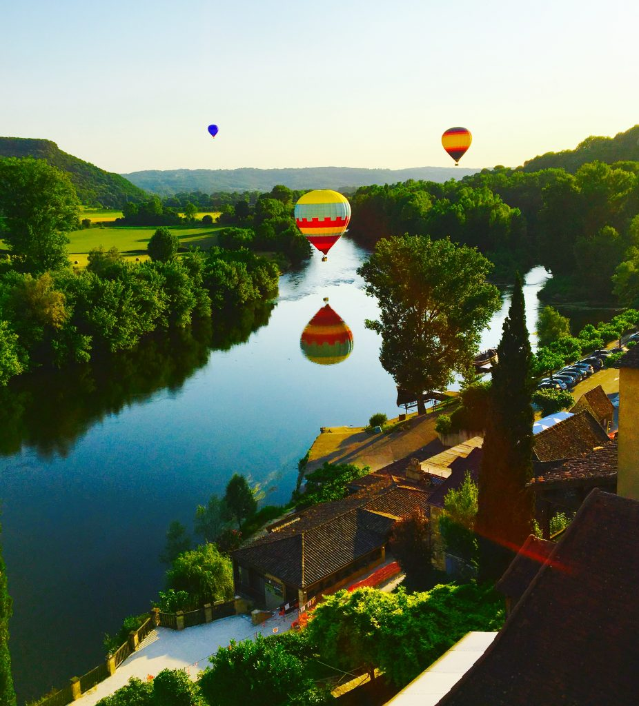 Hot Air Balloons over a river in Dordogne region of France.