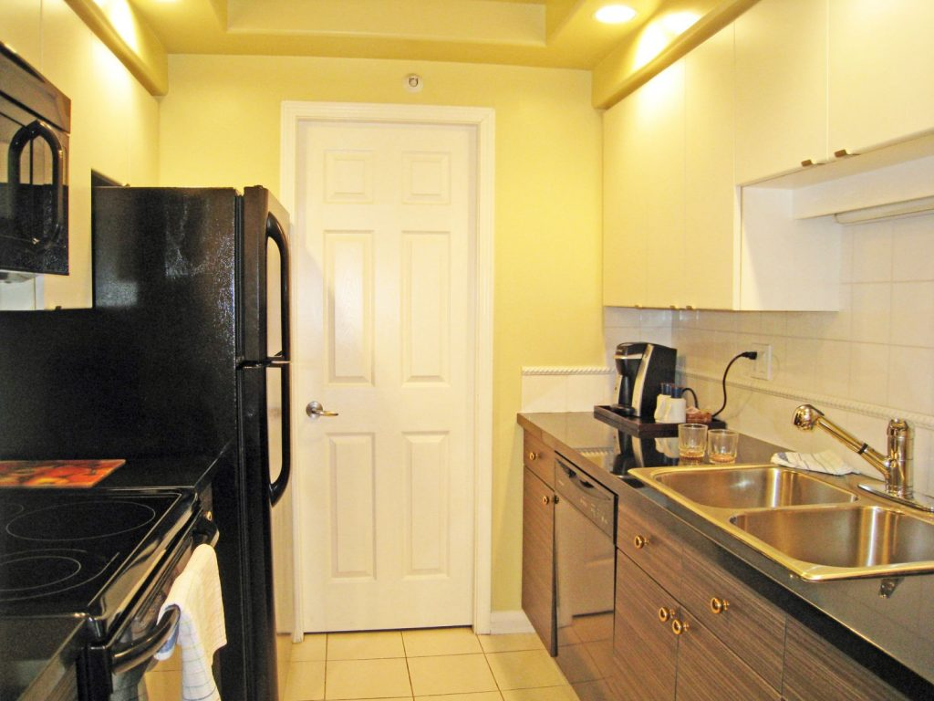 kitchen of suite in 2-bedroom hotel room